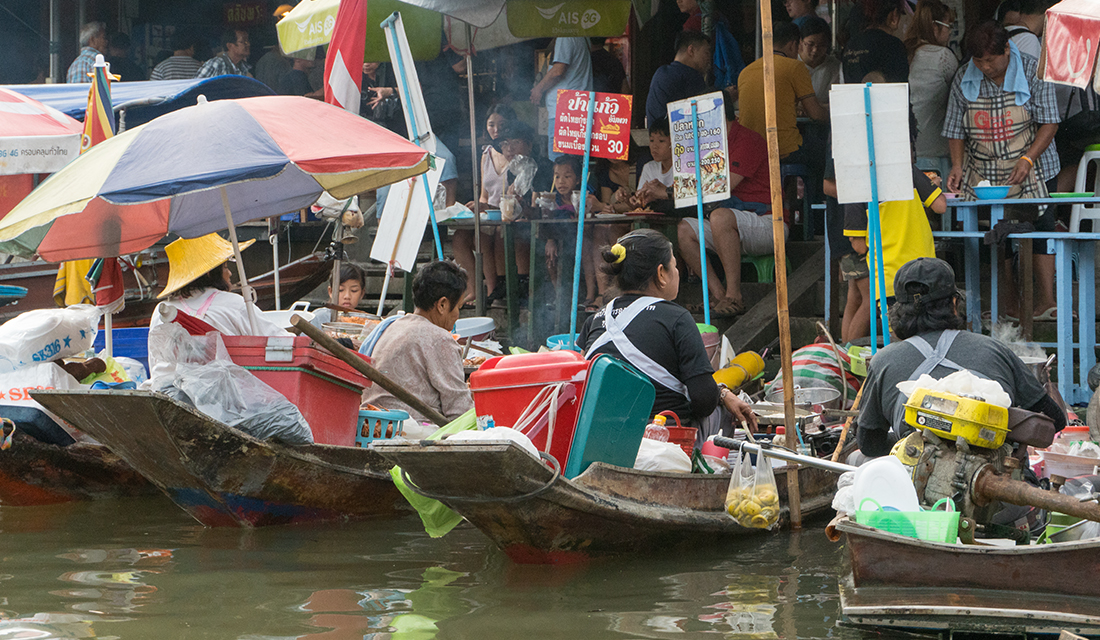 Local vendors selling goods from their boats.